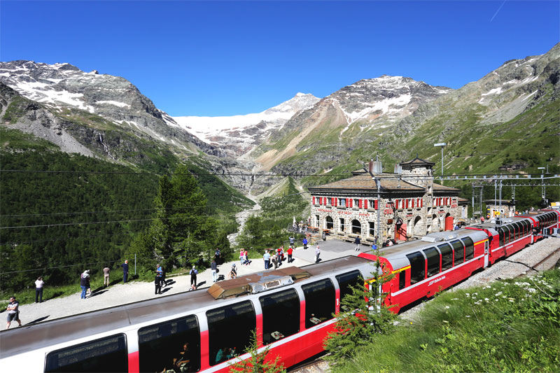 Alp Grüm station Bernina Express with view of Piz Palue and the glacier